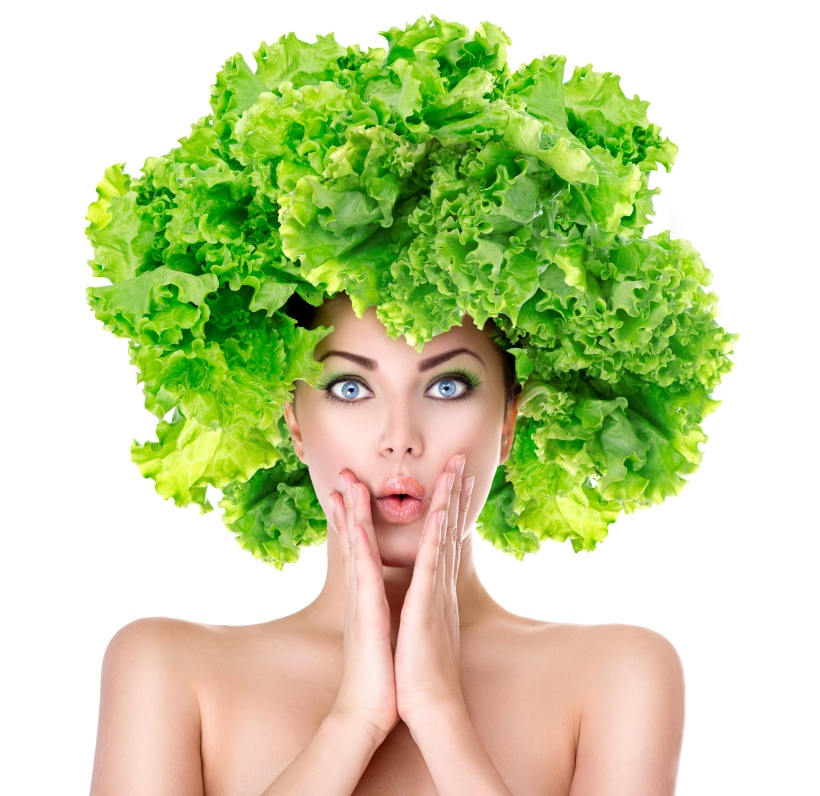 Surprised girl with green Lettuce hairstyle. Dieting concept